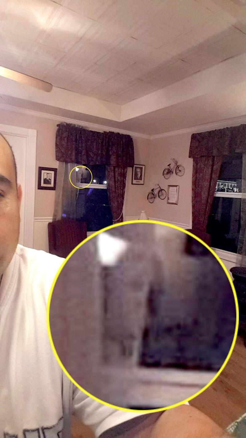 He spotted the 'ghost face' in the selfie. Photo: Caters News