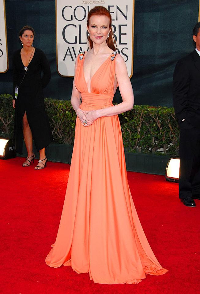 "Who says redheads can't pull off bright colors? Marcia Cross looked positively regal in this peach gown from 2006. Kevin Mazur/<a href=""http://www.wireimage.com"" target=""new"">WireImage.com</a> - January 16, 2006"