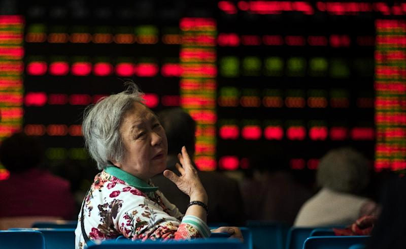 The benchmark Shanghai Composite Index has shed 13.32% this week (AFP Photo/Johannes Eisele)