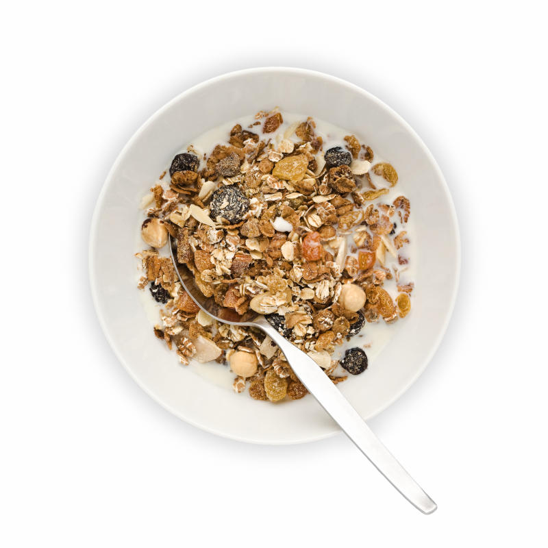 Cut out of overhead view of Bowl of Muesli with milk and spoon