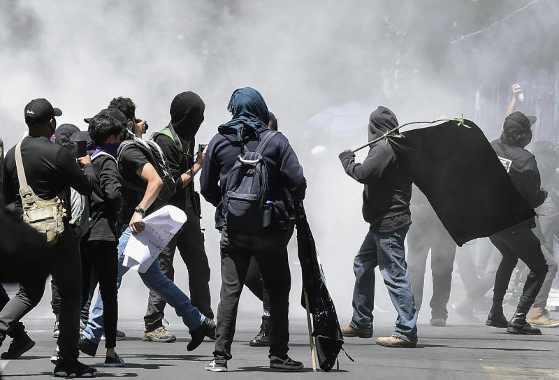 Demonstrators take part in a protest outside the US Embassy following the death of a young man while in police custody, after he had been arrested allegedly for failing to comply with measures to prevent the spread of COVID-19 coronavirus, in Mexico City on June 5, 2020. (Photo by ALFREDO ESTRELLA / AFP) (Photo by ALFREDO ESTRELLA/AFP via Getty Images)