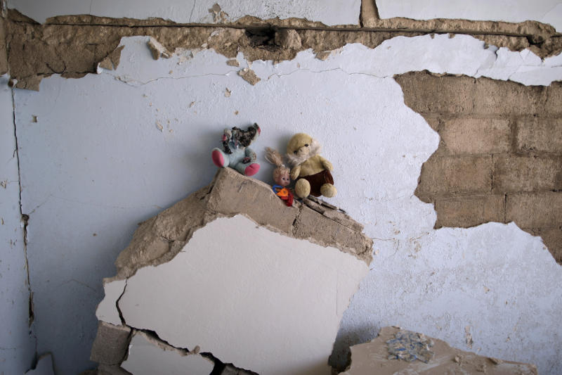 In this Wednesday, Aug. 29, 2012 photo, dolls that belonged to Sara, 11, and Youssuf Makour, 1.5, who died in a Syrian government airstrike on August, 15, 2012, that killed more than 40 people and destroyed more than a dozen of houses, were collected by their uncle Mahmoud and left on the rubble, in Azaz, on the outskirts of Aleppo, Syria. Over the past week, survivors and relatives have returned daily to collect from the rubble what can be salvaged as they also relive the day of the airstrike. (AP Photo/Muhammed Muheisen)