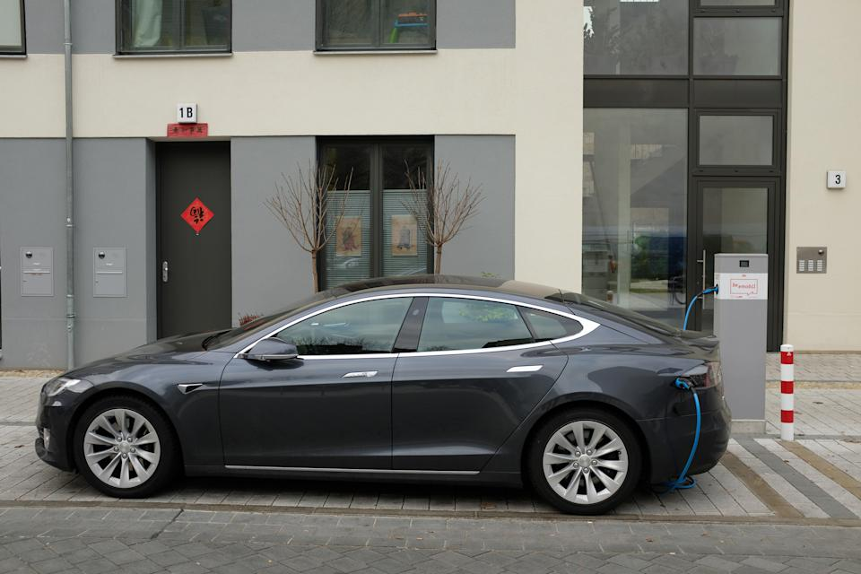 A Tesla Model S electric car charges at a public charging column on March 2, 2019 in Berlin (Getty Images)