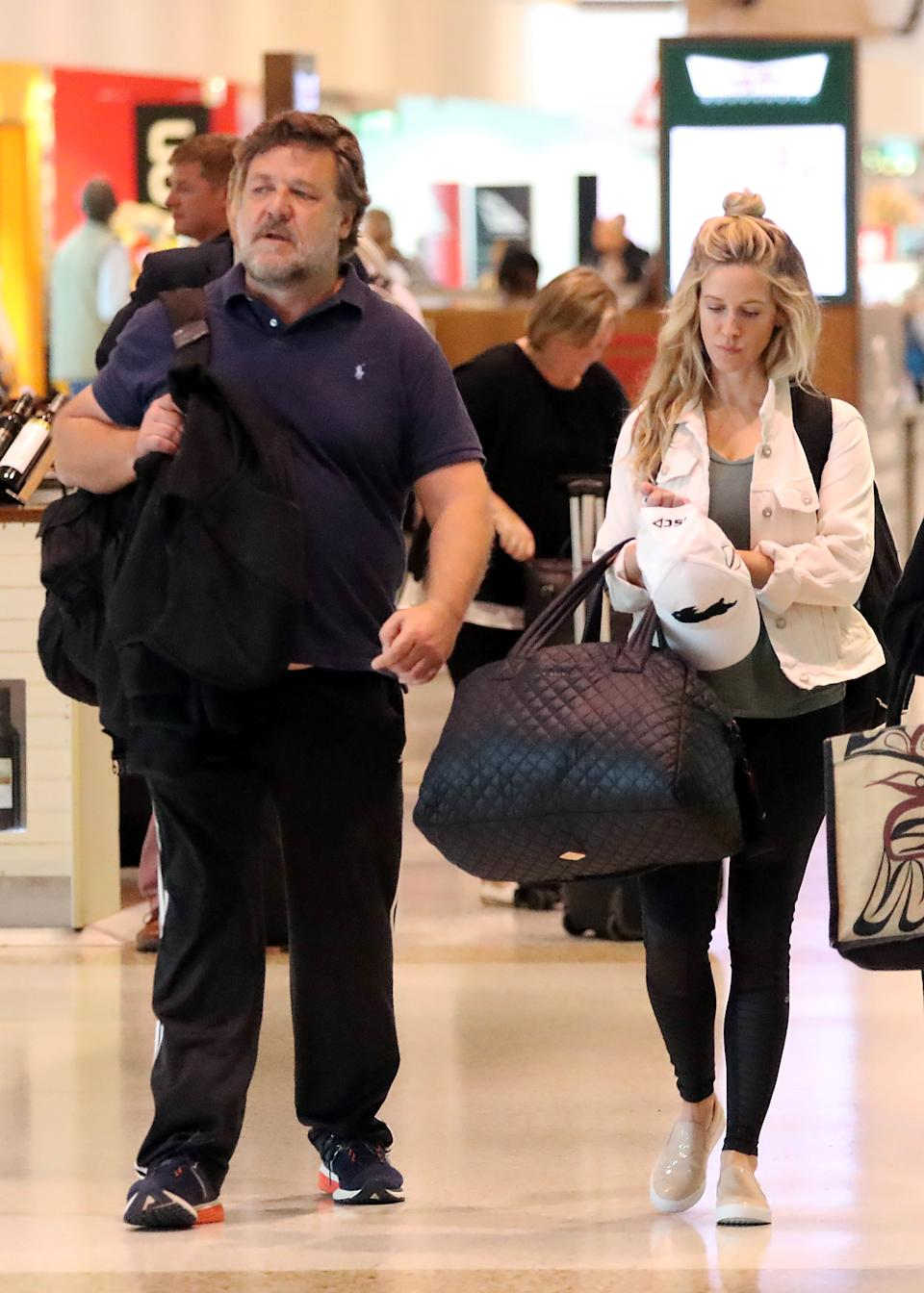 Russell Crowe and Britney Theriot touched down in Sydney on Friday. Photo: Diimex
