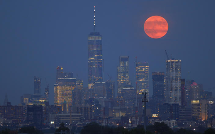 The full buck moon rises above the skyline of lower Manhattan and One World Trade Center in New York City on July 16, 2019, as seen from Kearney, New Jersey. / Credit: Gary Hershorn / Getty Images