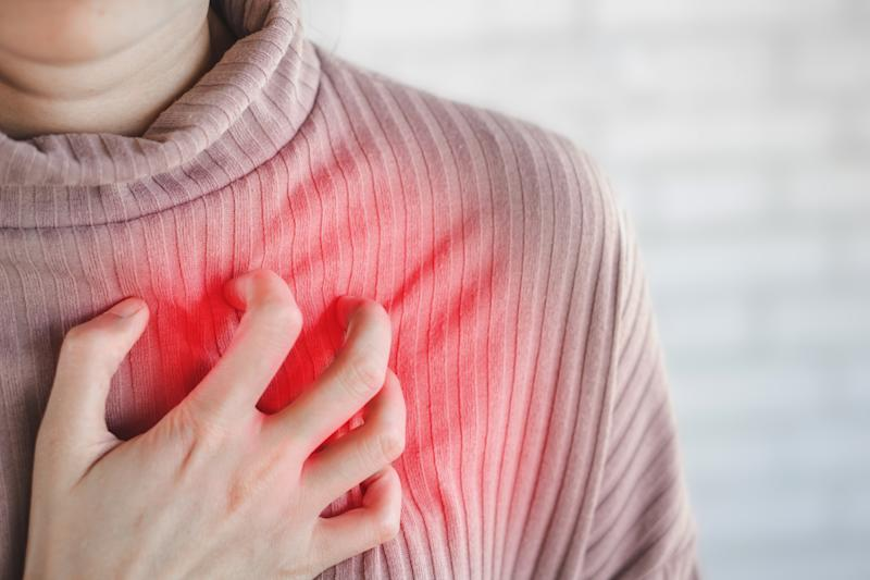 Asian woman hand touching her chest having heart attack, healthcare and medical concept