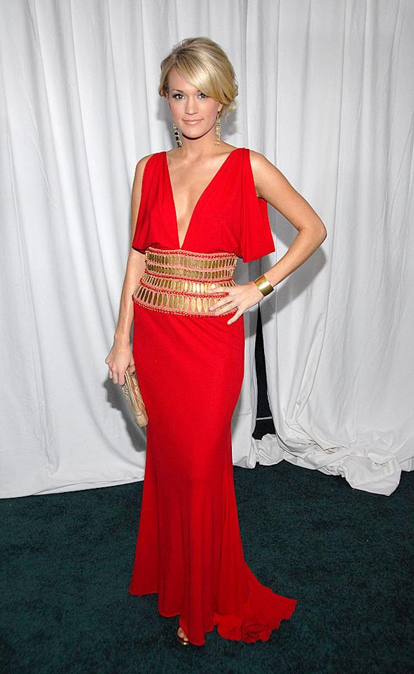 "Country cutie Carrie Underwood turns up the heat in a sexy scarlet gown. Frank Micelotta/<a href=""http://www.gettyimages.com/"" target=""new"">GettyImages.com</a> - December 2, 2007"