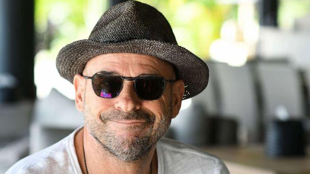 PHOTO: In this file photo taken on July 19, 2019, Guy Laliberte, co-founder of global circus company Cirque du Soleil, poses for a photo on his private island of Nuketepipi in French Polynesia. (Mike Leyral/AFP via Getty Images)