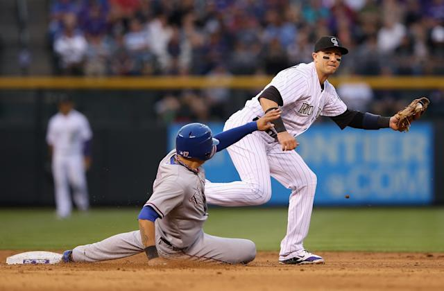 DENVER, CO - MAY 06: Shortstop Troy Tulowitzki #2 of the Colorado Rockies gets a force out on Shin-Soo Choo #17 of the Texas Rangers at second base in the third inning during Interleague play at Coors Field on May 6, 2014 in Denver, Colorado. (Photo by Doug Pensinger/Getty Images)