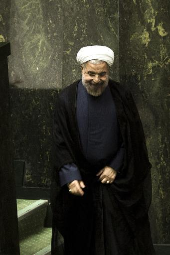 Iranian President Hassan Rouhani leaves the podium after delivering his speech during a parliament session in Tehran on October 27, 2013