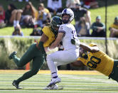 TCU quarterback Max Duggan (15) is hit on the helmet by Baylor safety Jalen Pitre, left, who was ejected for targeting during the first half of an NCAA college football game in Waco, Texas, Saturday, Oct. 31, 2020. (Jerry Larson/Waco Tribune-Herald via AP)