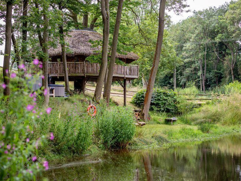 """<p><strong>When it comes to extraordinary escapes in the UK, you can't beat <a href=""""https://www.housebeautiful.com/uk/lifestyle/property/a20003491/britains-largest-treehouse-treetops-devon/"""" rel=""""nofollow noopener"""" target=""""_blank"""" data-ylk=""""slk:treehouse holidays"""" class=""""link rapid-noclick-resp"""">treehouse holidays</a>, where you can climb to new heights and live out your childhood dreams.</strong></p><p> Proving that adults can have just as much fun on a <a href=""""https://www.housebeautiful.com/uk/lifestyle/g32715553/beach-cottages-uk/"""" rel=""""nofollow noopener"""" target=""""_blank"""" data-ylk=""""slk:staycation"""" class=""""link rapid-noclick-resp"""">staycation</a> as the kids, the best treehouse stays in the UK offer all the magic and whimsical touches you'd expect from a getaway straight out of a fairy tale.</p><p>In fact, with our roundup of the top treehouse holidays in the country, there's more. Want a treehouse with a hot tub that's perfect for a romantic break for two? You'll want to keep scrolling. A treehouse holiday with acres of woodland and surrounding countryside for the children to run wild? We've picked our favourites for families too.</p><p>Romantic and family treehouse <a href=""""https://www.housebeautiful.com/uk/lifestyle/property/g33860597/christmas-cottage/"""" rel=""""nofollow noopener"""" target=""""_blank"""" data-ylk=""""slk:hideaways"""" class=""""link rapid-noclick-resp"""">hideaways</a> aside, you'll also find luxury treehouse stays, which come with incredible features. Think balconies to take in the views, king-sized beds and walk-in showers. Not forgetting log-effect fires and BBQ areas outdoors.</p><p>Whether you're after a treehouse holiday for two or eight, we think you'll enjoy browsing our terrific selection from the likes of <a href=""""https://go.redirectingat.com?id=127X1599956&url=https%3A%2F%2Fwww.holidaycottages.co.uk%2F&sref=https%3A%2F%2Fwww.housebeautiful.com%2Fuk%2Flifestyle%2Fproperty%2Fg33931209%2Ftreehouse-holidays%2F"""" rel=""""nofollow noopener"""" target=""""_blank"""" data-ylk="""""""