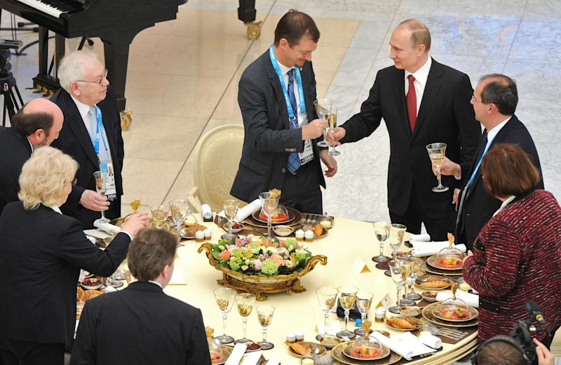 Russian President Vladimir Putin, third right, toasts with heads of national paralympic committees during a meeting in Sochi, Russia, Thursday, March 13, 2014. (AP Photo/RIA Novosti Kremlin, Mikhail Klimentyev, Presidential Press Service)