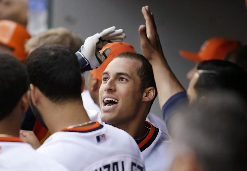Springer hits 2 HRs in Astros' 9-4 win over M's