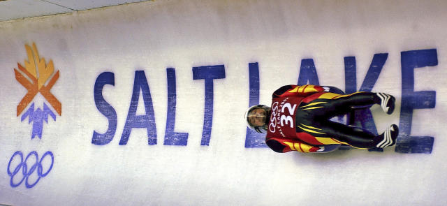 FILE - In this Feb. 9, 2002 ,file photo, Georg Hackl, of Germany, speeds past an Olympic logo during a practice run for the men's singles luge at the 2002 Salt Lake City Winter Olympics in Park City, Utah. Salt Lake City may shift its focus to bidding for the 2034 Winter Olympics rather than the games four years earlier following the announcement last month that Sapporo, Japan will bid for 2030, organizing committee members said Wednesday, Feb. 12, 2020. (AP Photo/Elise Amendola, File)