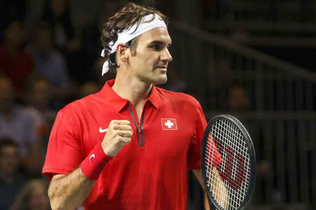 Roger Federer, of Switzerland, celebrates after beating Mikhail Kukushkin of Kazakhstan during the second single match of the Davis Cup World Group Quarterfinal match between Switzerland and Kazakhstan in Geneva, Switzerland, Friday, April 4, 2014. (AP Photo/Keystone, Salvatore Di Nolfi)