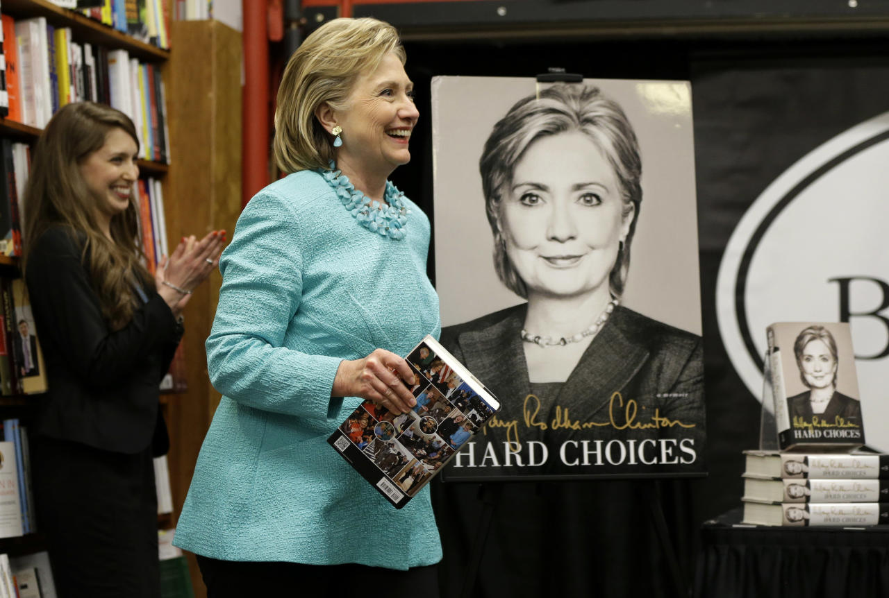 "HiIlary Rodham Clinton smiles as she arrives at a book signing for her new book ""Hard Choices,"" at Harvard Book Store, Monday, June 16, 2014, in Cambridge, Mass. (AP Photo/Steven Senne)"
