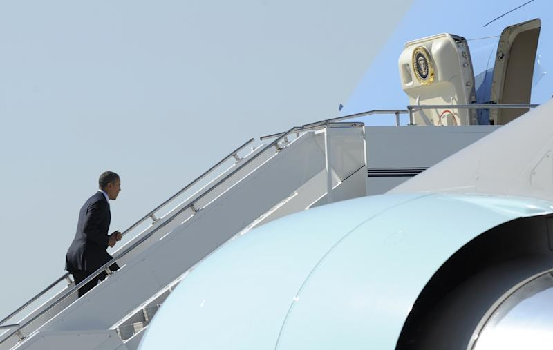 President Barack Obama walks up the steps of Air Force One at Boeing Field in Seattle, Wash., Wednesday, July 25, 2012. (AP Photo/Susan Walsh)