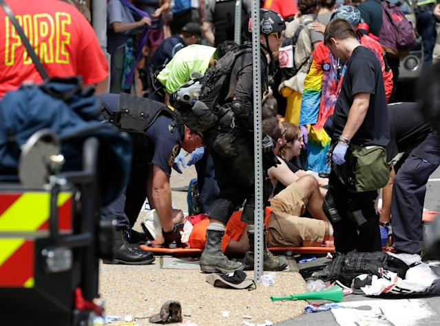 "<p>Rescue workers assist people who were injured when a car drove through a group of counter protestors at the ""Unite the Right"" rally Charlottesville, Va., Aug. 12, 2017. (Photo: Joshua Roberts/Reuters) </p>"