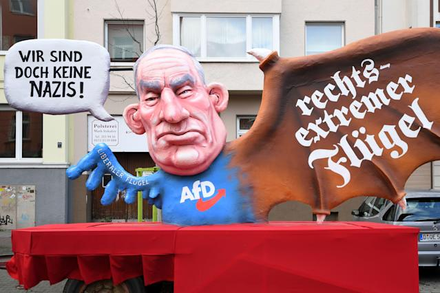 "<p>A carnival float, depicting co-leader of the parliamentary group of the Alternative for Germany (AfD) far-right party Alexander Gauland, is pictured during a carnival parade on Rose Monday on Feb. 12, 2018 in Duesseldorf, western Germany. The writings read ""We are not nazis at all"" (L) and ""far-right wing""(R). Germany. (Photo: Patrik Stollarz/Getty Images) </p>"