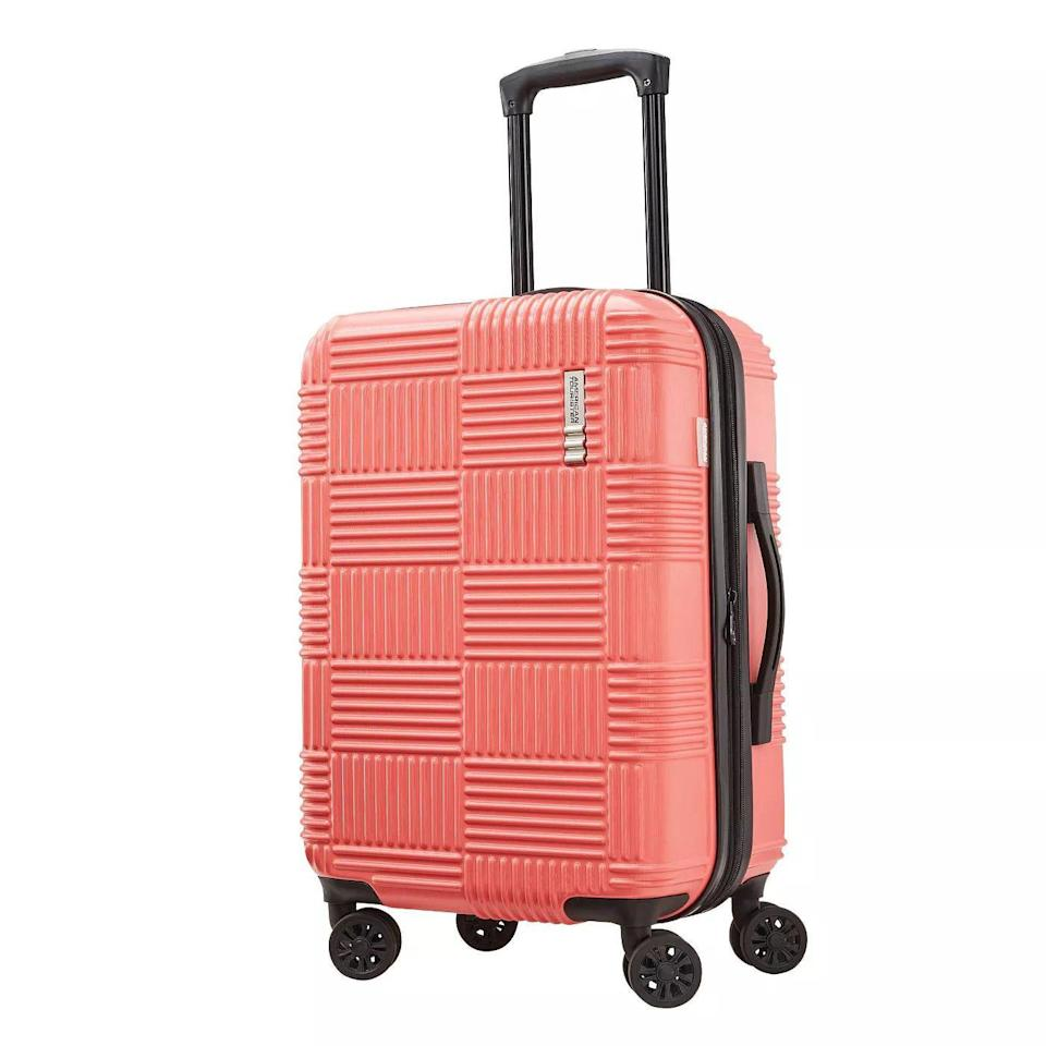 <p>Don't be fooled by this tiny little hard shell suitcase — it actually holds an impressive amount, and there's even an expansion feature, this way you can unzip for more room. Plus, it comes in five bright color ways, so you can find one to suit your specific aesthetic.</p>
