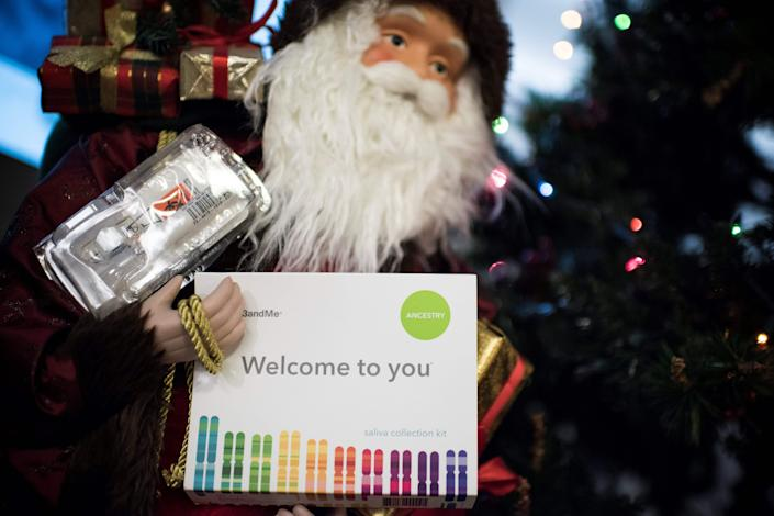 A saliva collection kit for DNA testing is displayed in the arms of a Father Christmas doll. (Eric BARADAt/AFP)