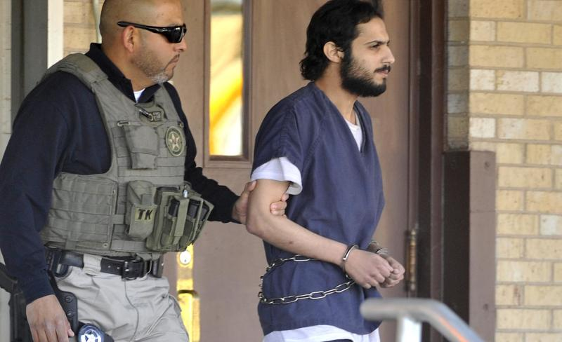 CORRECTS NAME TO KHALID ALI-M ALDAWSARI, NOT KHALID ALI-ALDAWSARI - Khalid Ali-M Aldawsari, 22, right, is escorted from the federal courthouse in Amarillo, Texas by U.S. Marshals Tuesday Nov. 13, 2012 after being sentenced to life in prison on a federal charge of attempting to use a weapon of mass destruction in a Lubbock-based bomb-making plot. (AP Photo/Amarillo Globe-News, Michael Schumacher) MANDATORY CREDIT; MAGS OUT; TV OUT