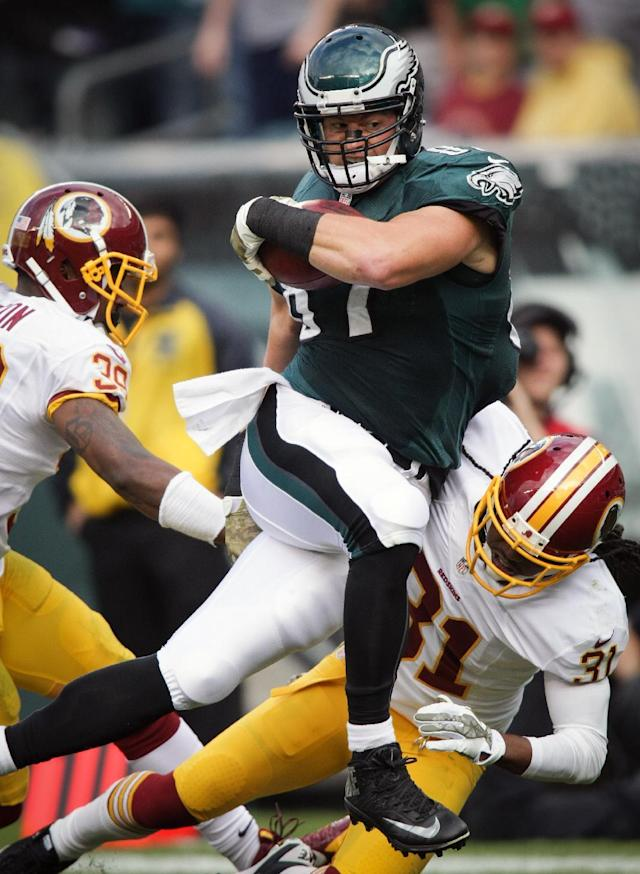 Philadelphia Eagles' Brent Celek fights for the extra yard during an NFL football game against the Washington Redskins in Philadelphia, Sunday, Nov. 17, 2013. (AP Photo/The News-Journal, Andre L. Smith)