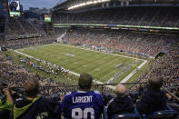 Fans at Lumen Field watch the first half of an NFL preseason football game between the Seattle Seahawks and the Denver Broncos, Saturday, Aug. 21, 2021, in Seattle. (AP Photo/Stephen Brashear)