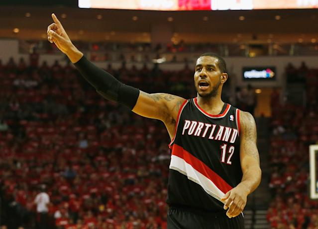 HOUSTON, TX - APRIL 23: LaMarcus Aldridge #12 of the Portland Trail Blazers celebrates a play on the court in the second half of the game against the Houston Rockets in Game Two of the Western Conference Quarterfinals during the 2014 NBA Playoffs at Toyota Center on April 23, 2014 in Houston, Texas. (Photo by Scott Halleran/Getty Images)