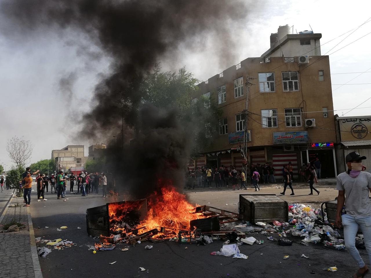 The Latest: Curfews imposed in some Iraqi cities amid unrest