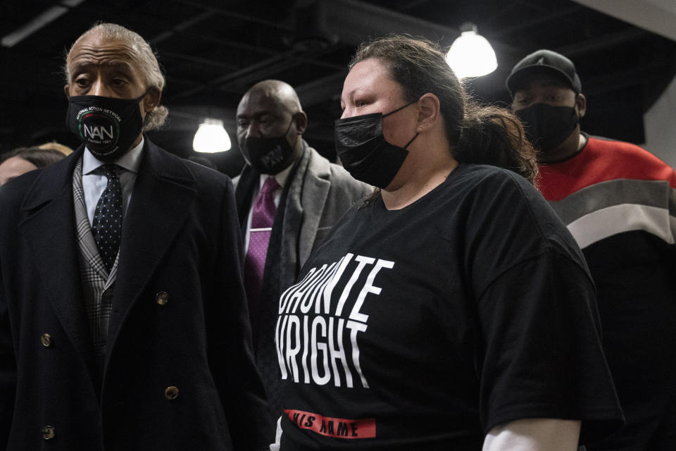 Katie Wright, mother of Daunte Wright, leaves Shiloh Temple International Ministries during her son's wake alongside Rev. Al Sharpton, left, and attorney Ben Crump, center left, Wednesday, April 21, 2021, in Minneapolis. The 20-year-old Wright was killed by then-Brooklyn Center police officer Kim Potter during a traffic stop. (AP Photo/John Minchillo)