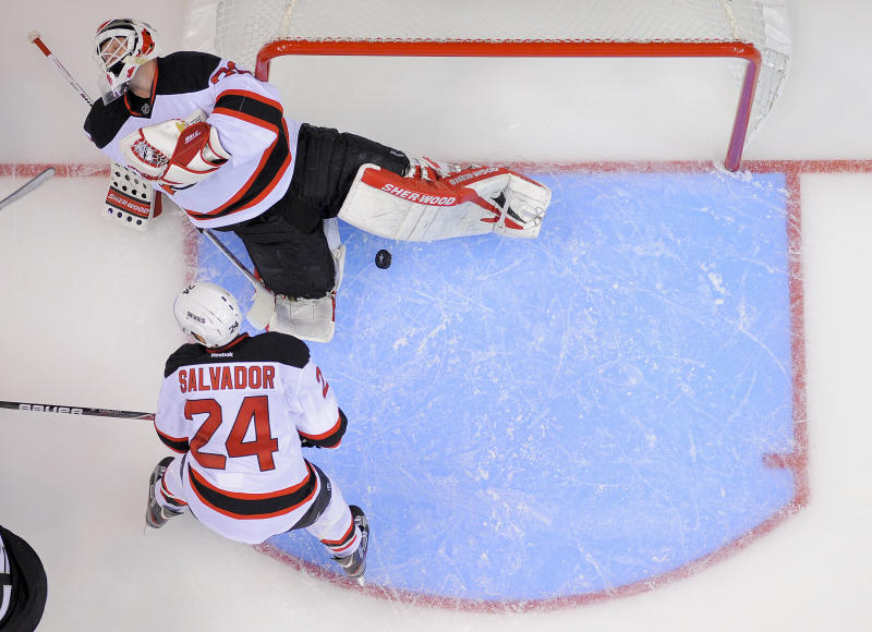 New Jersey Devils goalie Martin Brodeur (30) and New Jersey Devils defenseman Bryce Salvador (24) react after a goal by the Los Angeles Kings in the third period during Game 3 of the Stanley Cup Finals, Monday, June 4, 2012, in Los Angeles. (AP Photo/Mark Terrill)