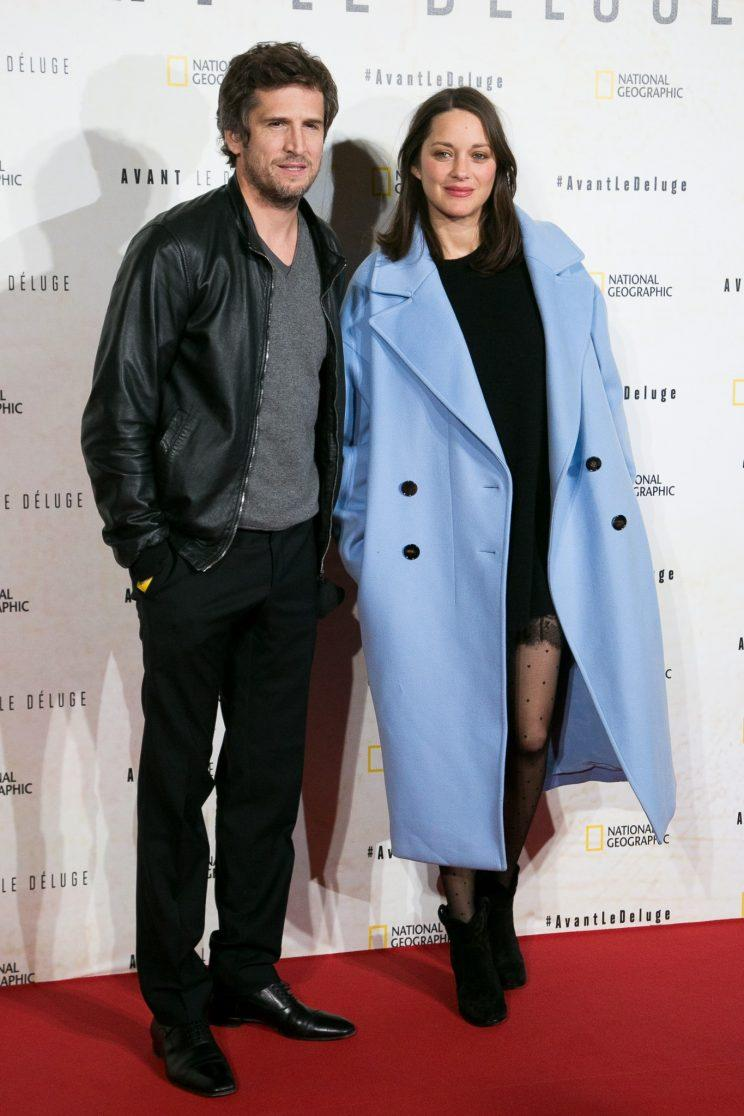 On the red carpet, Marion Cotillard wore an oversize blue Dior coat. (Photo: Getty Images)