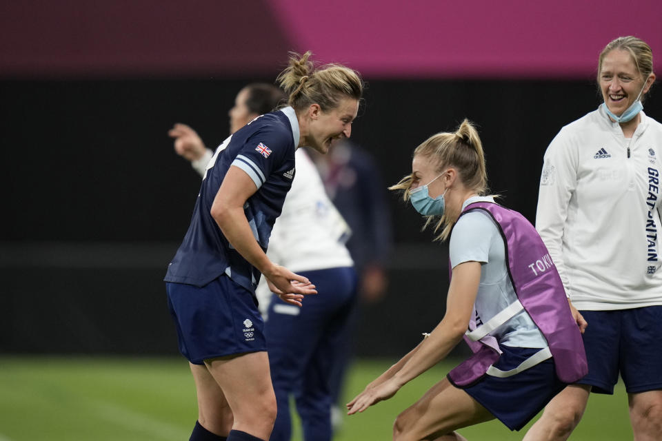 Britain's Ellen White, left, celebrates with teammates after scoring her side's opening goal against Chile during a women's soccer match at the 2020 Summer Olympics, Wednesday, July 21, 2021, in Sapporo, Japan. (AP Photo/Silvia Izquierdo)