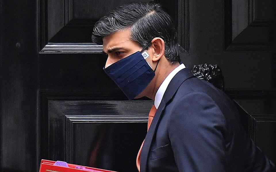 Rishi Sunak's temporary abolition of VAT on disposable face coverings will expire at the end of October - Justin Tallis/AFP