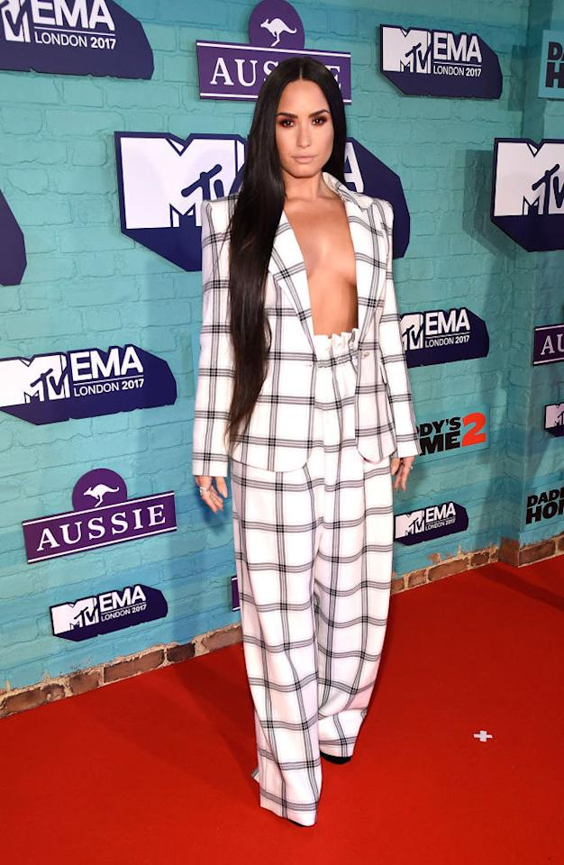 <p>Demi Lovato made a case for oversized checks this season in a tailored two-piece. She dangerously didn't wear a top — but still made it work. (Photo: Getty Images) </p>