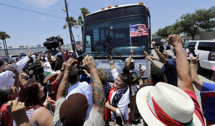 <p>Demonstrators block a bus with immigrant children onboard during a protest outside the U.S. Border Patrol Central Processing Center Saturday, June 23, 2018, in McAllen, Texas. Extra law enforcement officials were called in to help control the scene and allow the bus to move. (Photo: David J. Phillip/AP) </p>