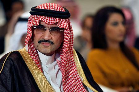 FILE PHOTO - Saudi billionaire Prince AlWaleed bin Talal looks on during a news briefing in Manama, May 8, 2012. REUTERS/Hamad I Mohammed/File Photo