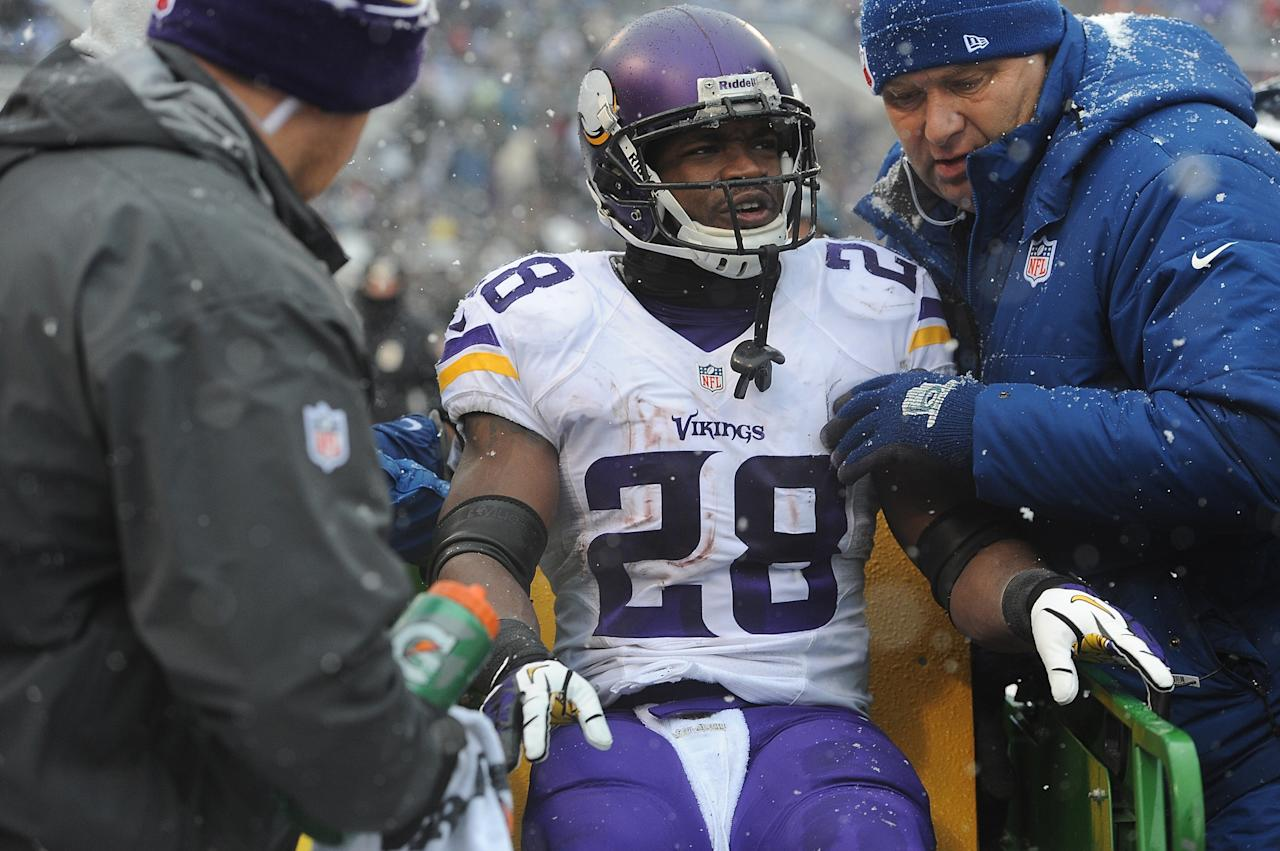BALTIMORE, MD - DECEMBER 08: Running back Adrian Peterson #28 of the Minnesota Vikings is taken off the field after being injured during the second quarter of the game against the Baltimore Ravens at M&T Bank Stadium on December 8, 2013 in Baltimore, Maryland. (Photo by Larry French/Getty Images)