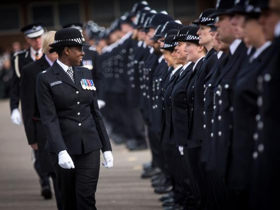 New recruits to the Metropolitan Police Service are inspected by Superintendent Robyn Williams during their passing out parade at Hendon Training Centre on 13 March 2015 in London ( Rob Stothard/Getty Images)