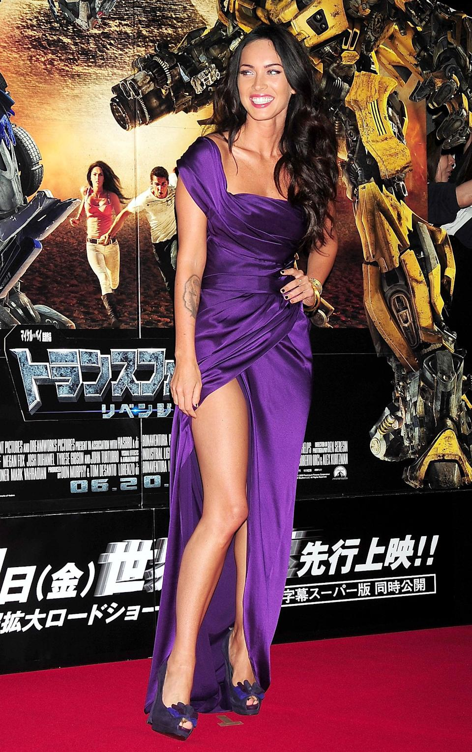 <p>You'll notice a trend with the gowns Megan chose for the <b>Transformers: Revenge of the Fallen</b> premieres tour in 2009. This royal purple Donna Karan dress featured a high-cut leg slit with ruched detailing along the torso. </p>