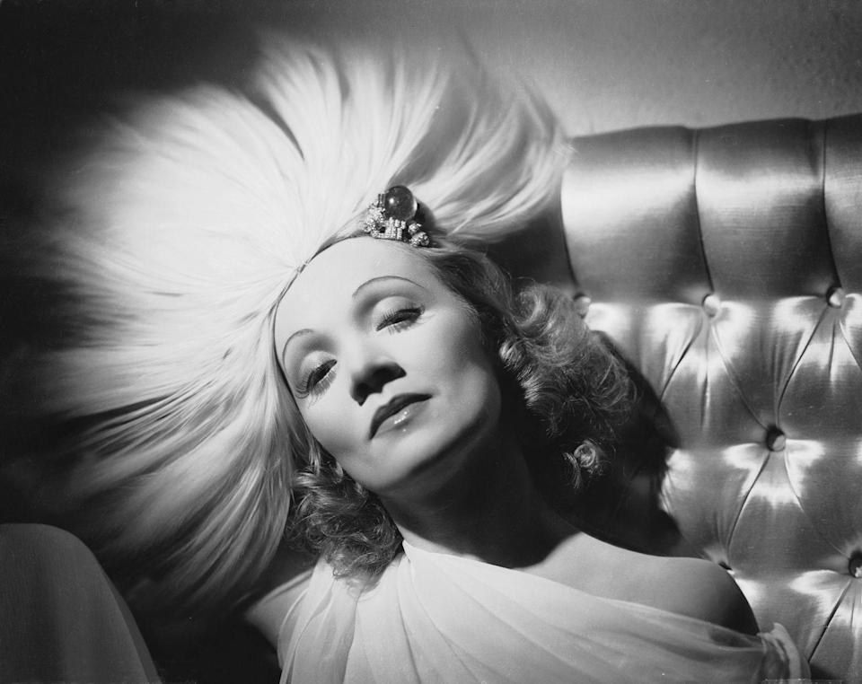 <p>A bejeweled and feathered headdress designed by Travis Banton for the film <em>Angel</em>, which was directed by Ernst Lubitsch, only adds to Dietrich's enticing gaze. <br></p>