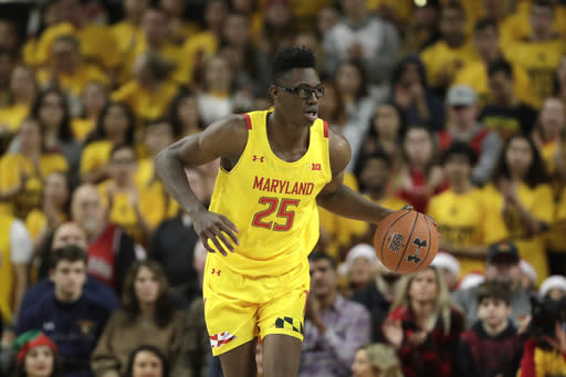 FILE - In this Dec. 7, 2019, file photo, Maryland forward Jalen Smith dribbles up court against Illinois during the second half of an NCAA college basketball game in College Park, Md. Smith was selected by the Phoenix Suns in the NBA draft Wednesday, Nov. 18, 2020. (AP Photo/Julio Cortez, File)