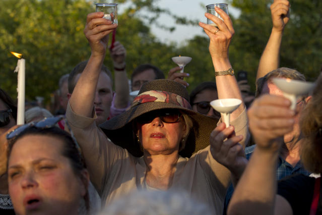 <p>People gather for a candlelight vigil across the street from where five journalists were slain in their newsroom in Annapolis, Md., Friday, June 29, 2018. Prosecutors say Jarrod W. Ramos opened fire Thursday in the Capital Gazette newsroom. (Photo: Jose Luis Magana/AP) </p>