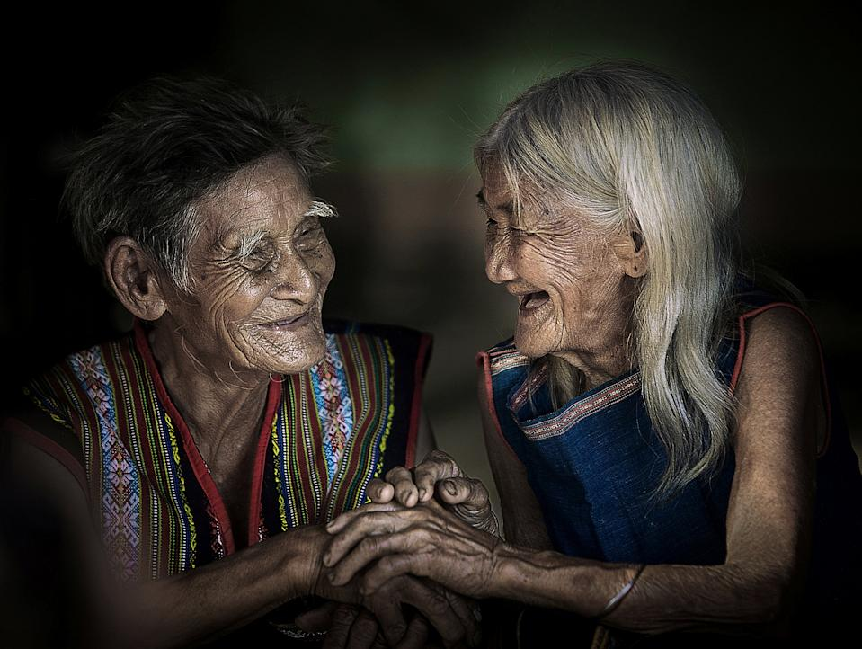 """@quoclinhvinhnguyen spotted this elderly couple from the Xe Dang minority group in Kon tum, Vietnam: """"It is a great feeling to see an old couple of nearly 90 years old taking care of each other happily."""" [Photo: SWNS]"""