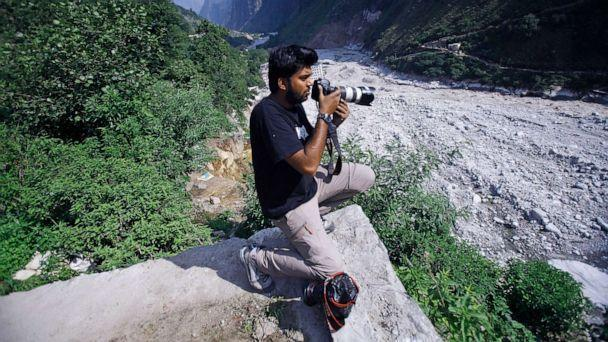 PHOTO: Reuters photographer Danish Siddiqui covers the monsoon floods and landslides in the upper reaches of Govindghat, India, June 22, 2013. (Rafiq Maqbool/AP, FILE)