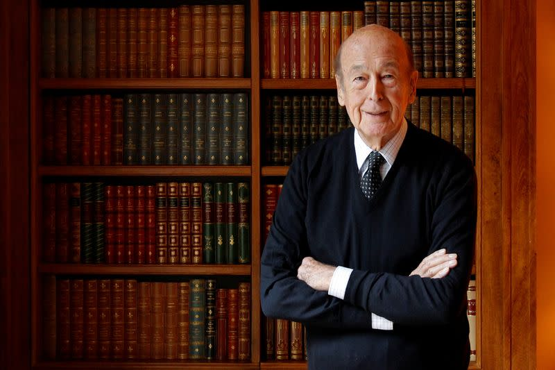 FILE PHOTO: Former French President Valery Giscard d'Estaing poses in his office at his Paris home