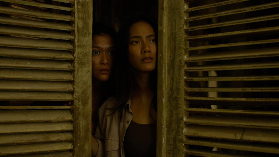 """Tara Basro (right, with Marissa Anita) stars as a woman who investigates a remote Indonesian village with the residents want to kill her and break an old curse in """"Impetigore."""""""