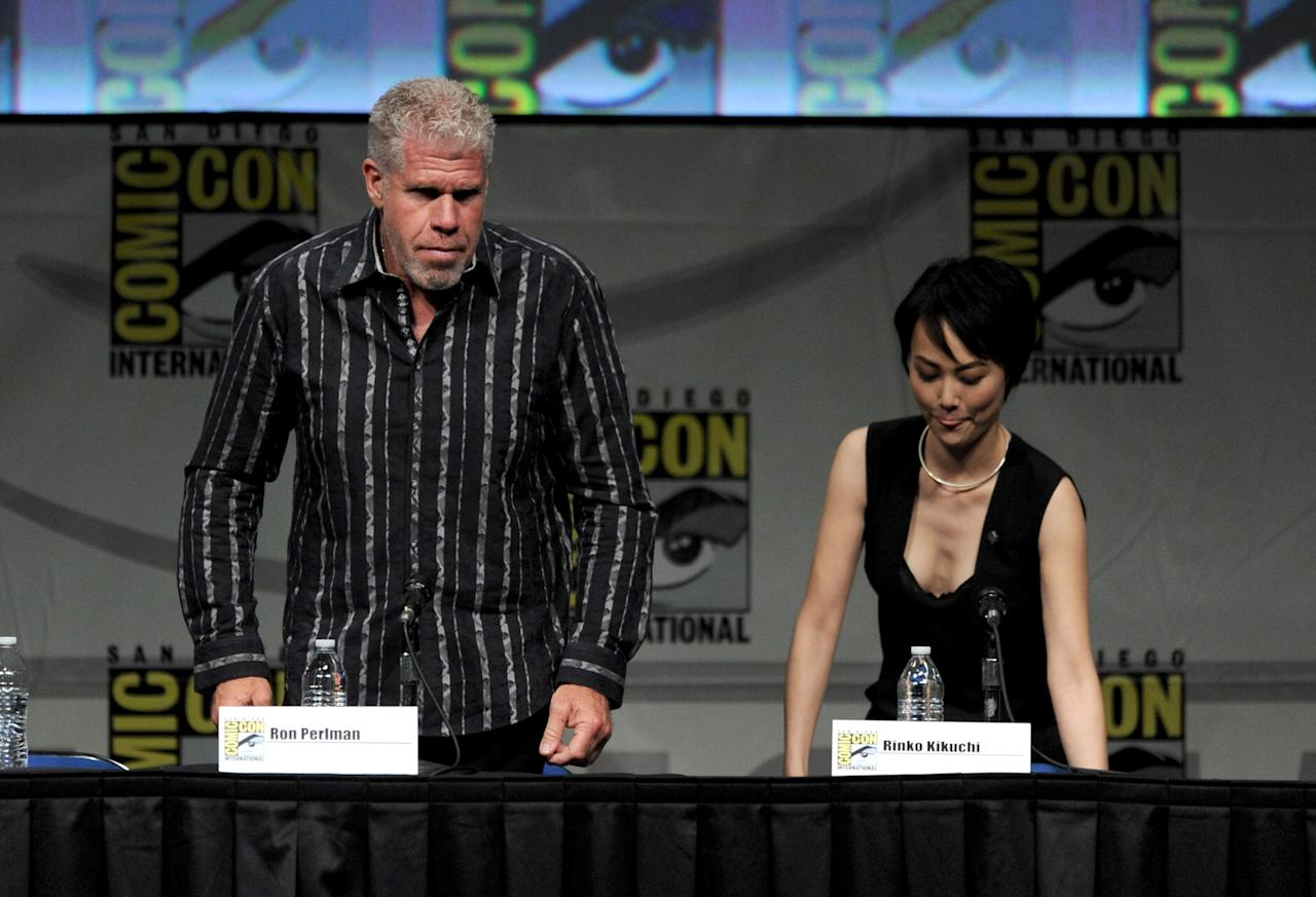 "SAN DIEGO, CA - JULY 14:  (L-R) Actors Ron Perlman and Rinko Kikuchi speak at Warner Bros. Pictures and Legendary Pictures Preview of ""Pacific Rim"" during Comic-Con International 2012 at San Diego Convention Center on July 14, 2012 in San Diego, California.  (Photo by Kevin Winter/Getty Images)"